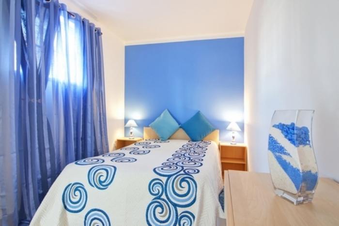 A small bedroom in blue. In Decoration.
