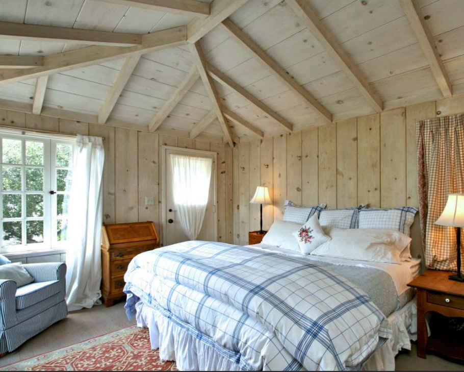 cottage-bedroom-with-paneled-walls-and-ceilings